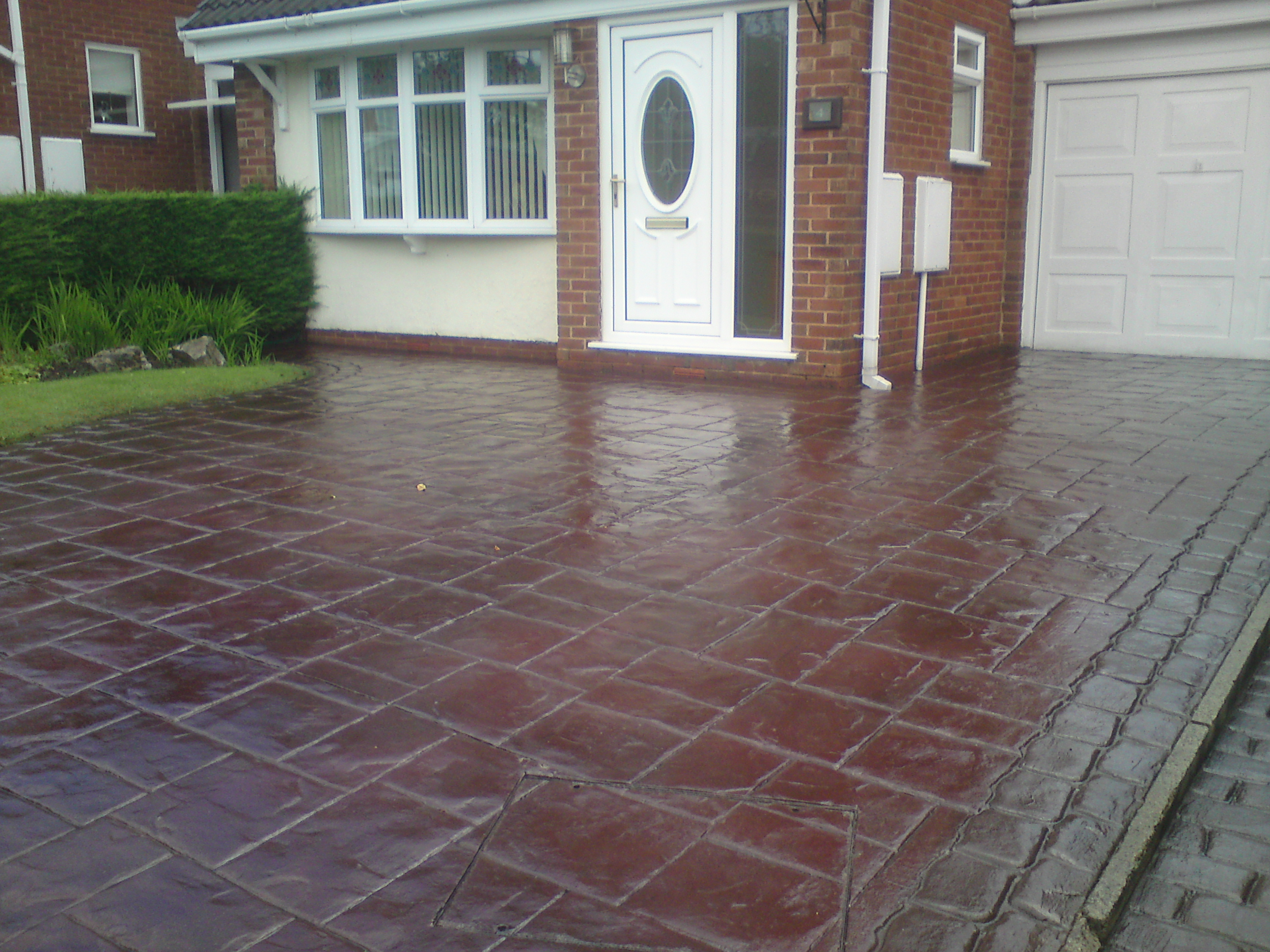 Pressure washing services driveway cleaning manchester for Cleaning colored concrete